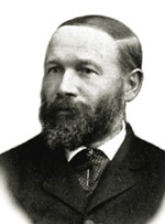 Black and white photo of George Ulrich in a suit and beard