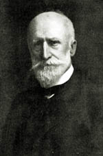Black and white photo of Alfred Howitt wearing a suit and neat white beard