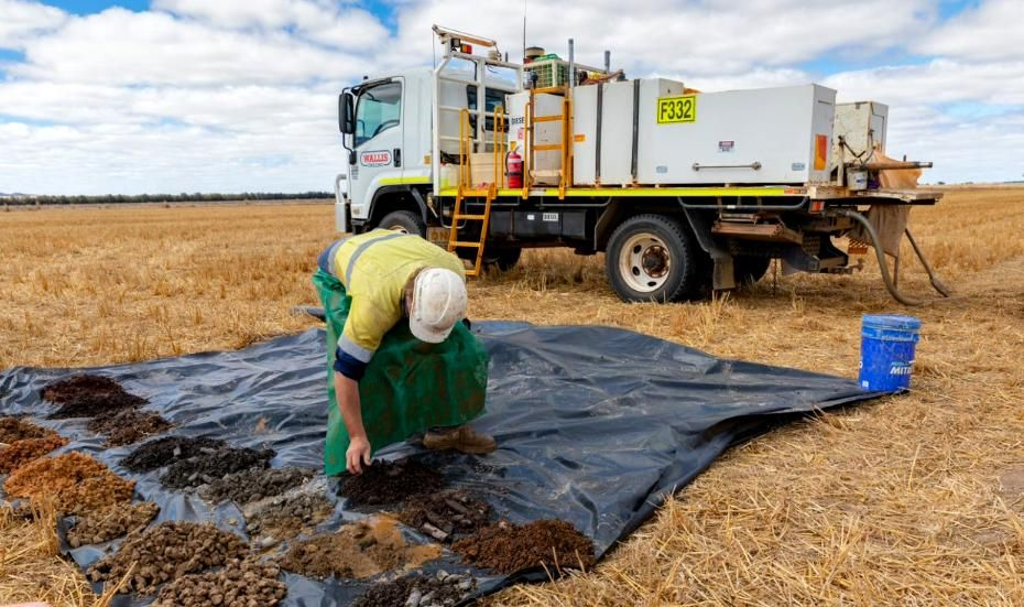 Man sorting soil samples in a field