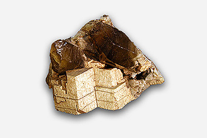 A fragment of feldspar which is gold in colour.