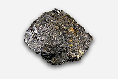 A zinc fragment. It is dark grey in colour with golden specks.
