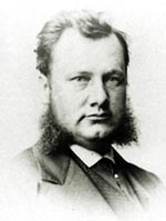Black and white photo of Richard Kitto wearing a suit and beard